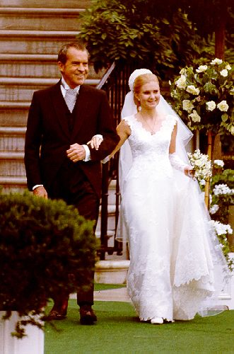 President Richard Nixon escorting his daughter Tricia to her marriage to Edward Cox at a historic White House wedding in 1971.