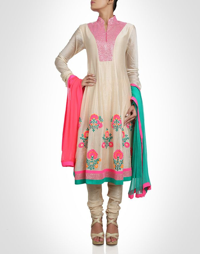 Beige suit with multi coloured embroidery. Shop Now: www.kimaya.in