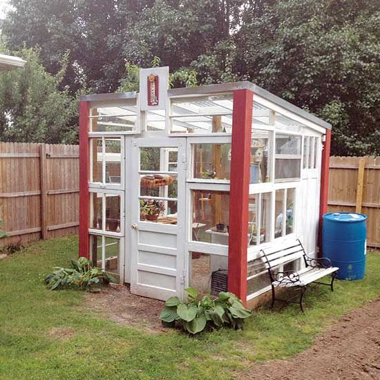 Repurpose old glass windows and doors by assembling them into a beautiful and unique greenhouse.