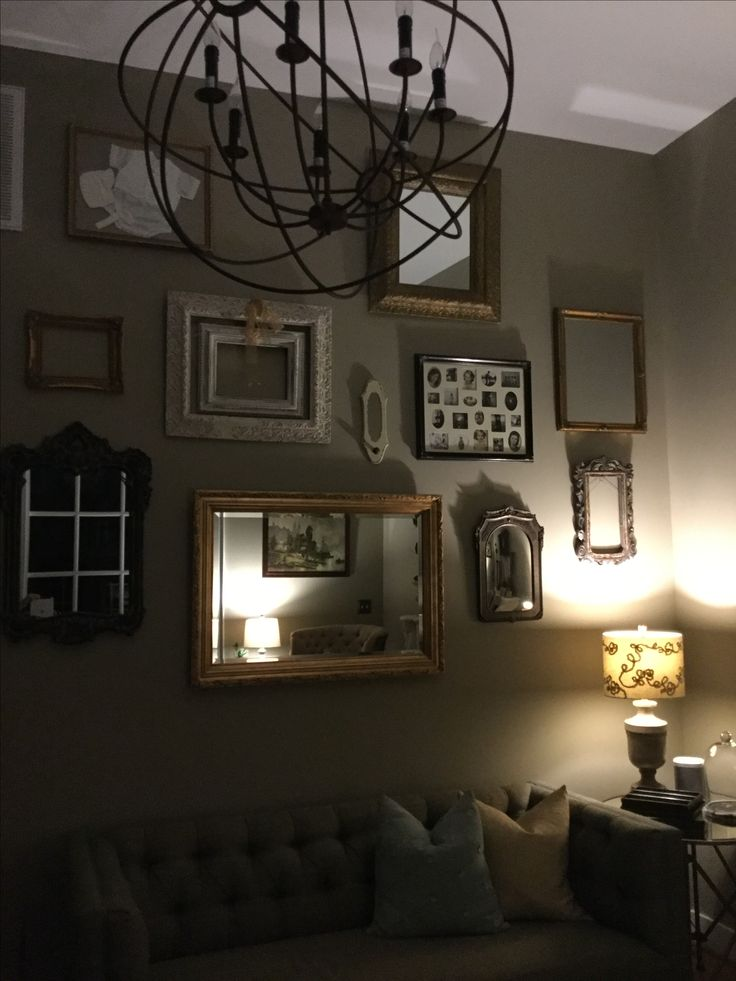 Eclectic frames and mirrors for a shabby chic or French country room.