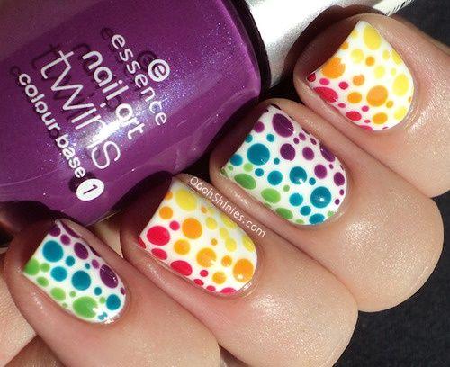 Rainbow dot nails.