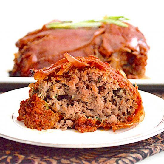 This is an amazing Italian meatloaf coated in sun-dried tomato pesto sauce, then wrapped in prosciutto. Perfect comfort food!