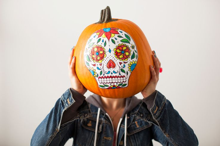 Use a template to make this colorful no-carve sugar skull pumpkin.