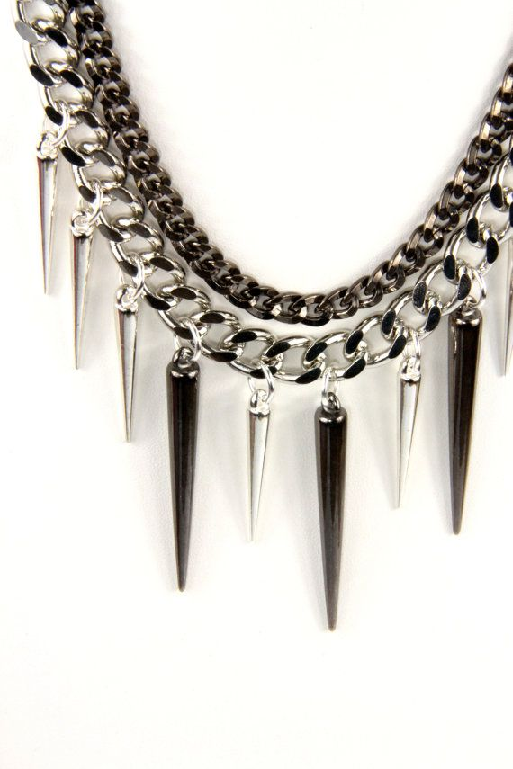 Jewels for Ghouls: Multi-Chain Gunmetal and Silver Spike Necklace by Calypte Collection of Los Angeles. $30.