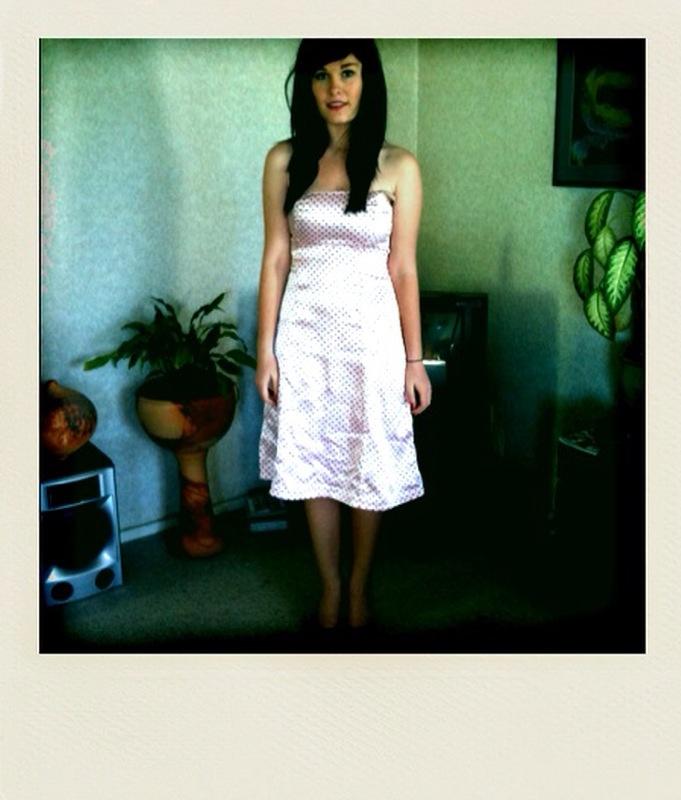 Polka-dot strapless dress.
