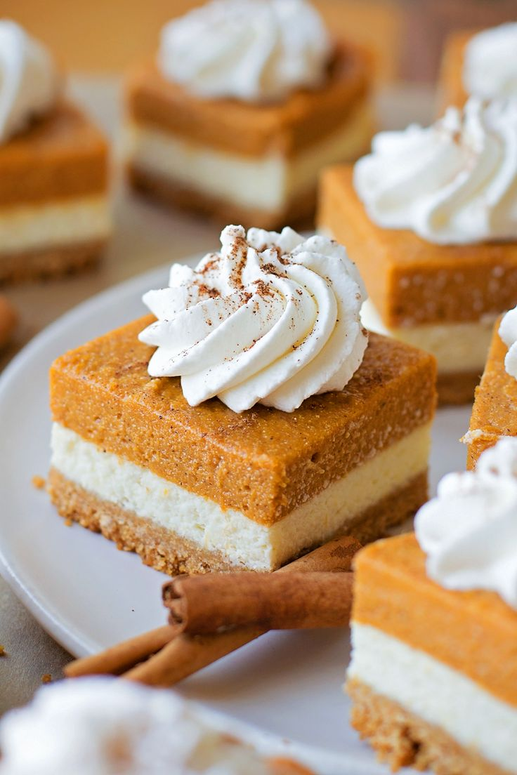 Pumpkin Pie Cheesecake Bars - layers of goodness with a graham cracker crust, cheesecake layer and pumpkin layer.