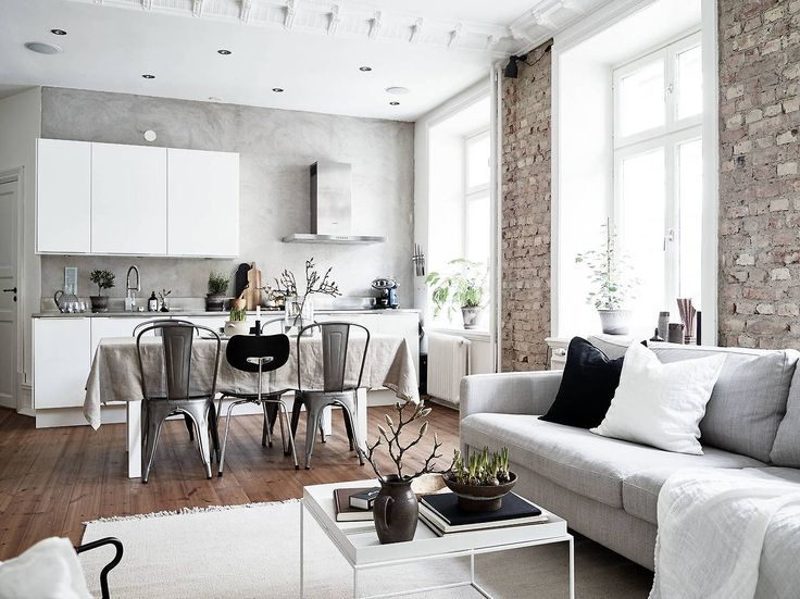 Modern studio apartment with exposed brick and concrete walls