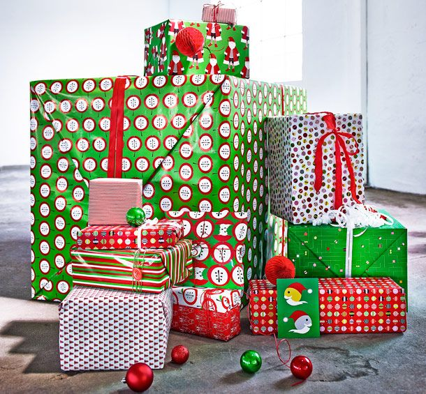 A pile of Christmas presents wrapped in green/red/white gift wrap in different patterns
