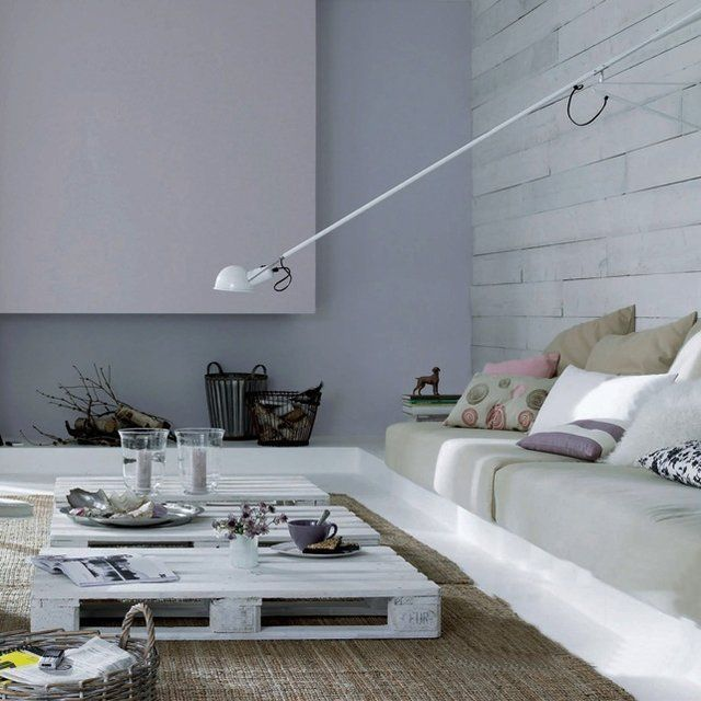 The design is GREAT.  love the light fixture and it's elegant long arm.  Crazy about the pallett coffee table and how the sofa compliments the low profile.  L-O-V-E the grey tones with a punch of purple (pinks, blues & browns).  a Great room.