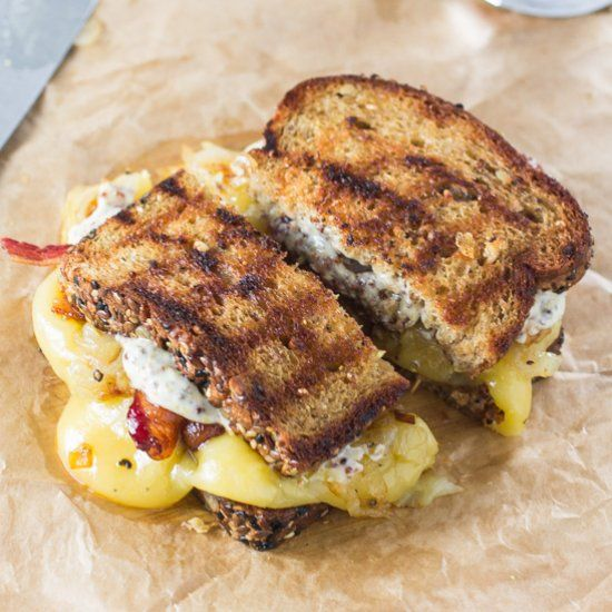 This Trainwreck Grilled Cheese- Gouda, caramelized onions and maple whiskey bacon. Yes please.