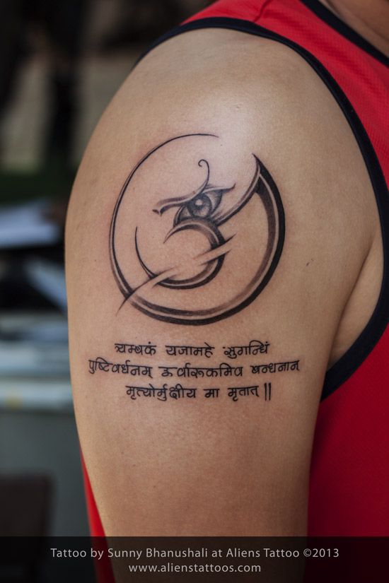 Aum with mantra tattoo by Sunny Bhanushali at Aliens Tattoo Mumbai. Its a very creative tattoo design isn't it?. Client wanted a simple Aum tattoo, however we sketched this amazing tattoo concept. Client loved it to the core. Share it if you like it.