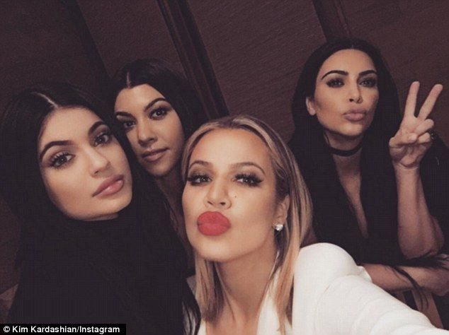 'Sister Sunday': Kim posed for a selfie with (L-R) Kylie, Kourtney and Khloe inside the restaurant