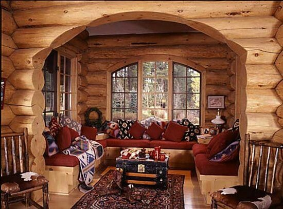 Cozy cabin nook with built in benches serving as both storage and seating