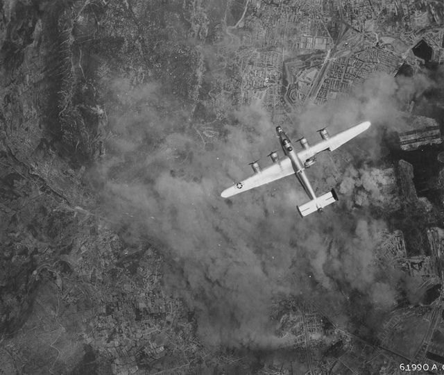 A damaged B-24 Liberator from the  376th American bombardment in flight over Toulon 1944 (my grand-ma was down there at the time of the pic!) #plane #WW2