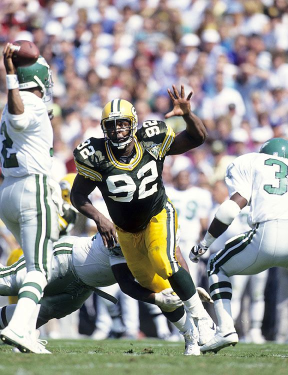 Reggie White, Green Bay Packers...DO YOU HEAR FOOTSTEPS?  This guy rocked.