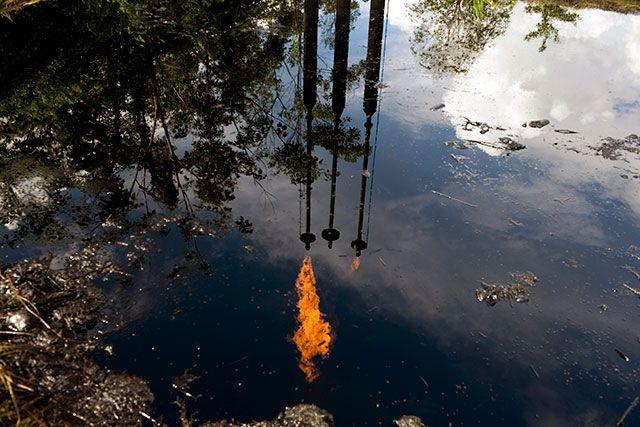A pool of oil on May 1, 2009, in Lago Agrio, an Ecuadorean town in the Amazon where Texaco left contamination. (Photo: Moises Saman / The New York Times)