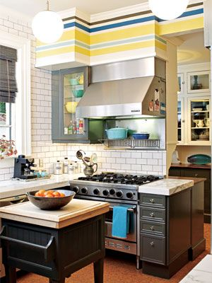 In love with the bright kitchen colors - and the matching dishes.