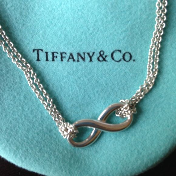 "Tiffany silver Infinity necklace Beautiful, 100% authentic Tiffany & Co. infinity necklace, featuring a 18"" chain. In nearly perfect condition, comes in Tiffany bag. Proof of retail price in last photo. Additional photos can be taken, upon request. Tiffany & Co. Jewelry Necklaces"