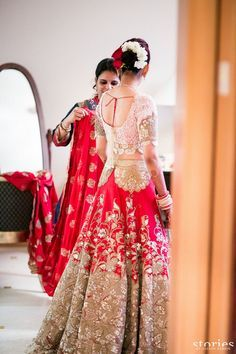 #IndianWedding Bridal Wear - Red Bridal #Lehenga w/ Lace Blouse | #WedMeGood | Anamika Khanna White, Red and Gold Lehenga with Lace Patch Work. via @topupyourtrip