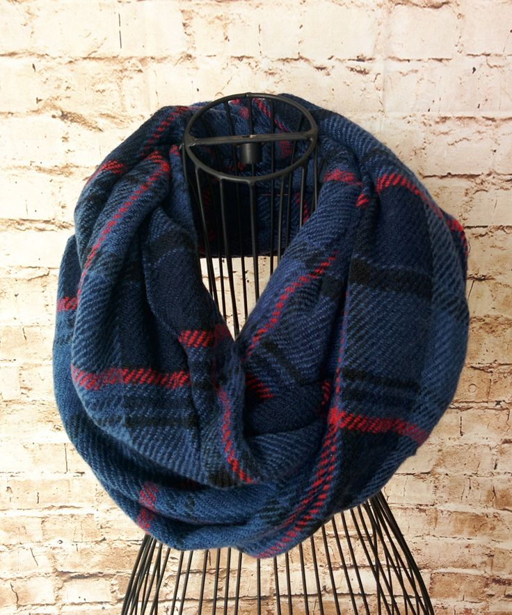 What a fun twist on traditional plaid colors! The blue totally pops on this infinity scarf. Perfect for transitioning fall to winter. This is infinity style and super soft, with just a bit of texture