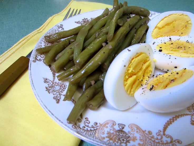 A healthy lunchfor a happy heart!  Green beans and boiled eggs, with a few condiments. Personally, I'd add some parsley and basil as well - and I also like my eggs softer boiled.  But hey, that's what recipes are for! Improving them with your own preferences!