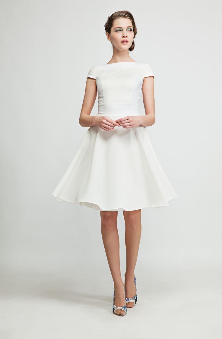 This flowing white dress is made from stretch cotton satin and chiffon and makes you flitter through the sunny summer days. www.marimofashion.com