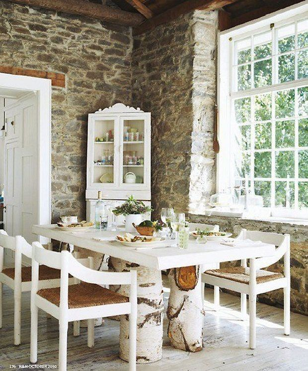 Shabby chic airy space with rustic dining room set - White wooden dining table and chairs with rattan.