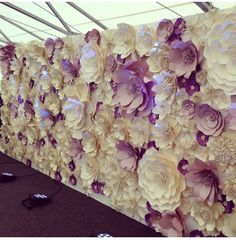 paper flowers backdrop. I think this is more tasteful than some I've seen and I like the idea of this being a lilac color along with the cream as an accent.