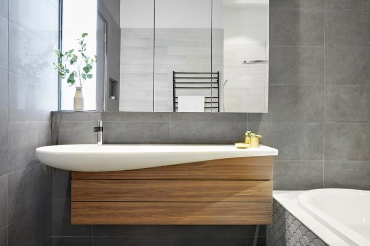 Smarter bathrooms and kitchens - modern bathroom designed by bathroom renovations specialist in Melbourne, with a beautifully designed sink in Hawthorn Home — Ensuite Bathroom.