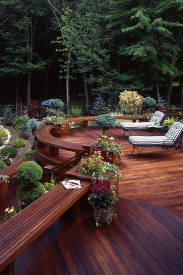Gorgeous deck (love the wood color). I would love if it was different levels. Terrible deck furniture though... lol
