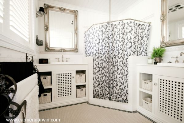 Our very compact little bathroom utilises the small amount of space we had to play with. A vanity each separated by the shower works quite well for us. http://www.carmendarwin.com/about/