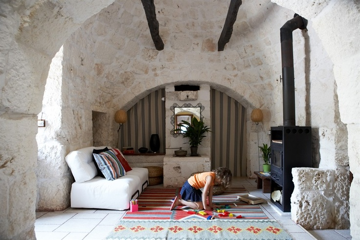 living in a trullo - a stone, conical-shaped house traditional to south-east Italy