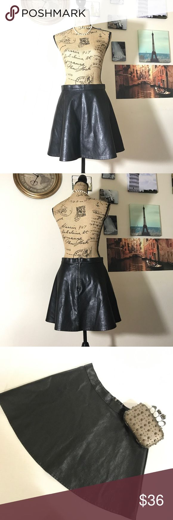 "American Eagle Outfitters faux leather skirt Sz 10 Adorable skater skirt with a zipper in the rear.  Waist measures 15"" across the front flat laid and is 15.5"" in length.  EUC - flawless!  03111111117 American Eagle Outfitters Skirts Circle & Skater"