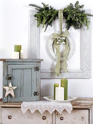 Picture Perfect     Layer pieces to create a seasonal display. Hang a large empty frame on the wall, then use a wide ribbon to suspend a smaller one in the center. Tuck a swag of greenery under the ribbon along the edge of the top frame, and tie an ornament to the bow that holds the small frame