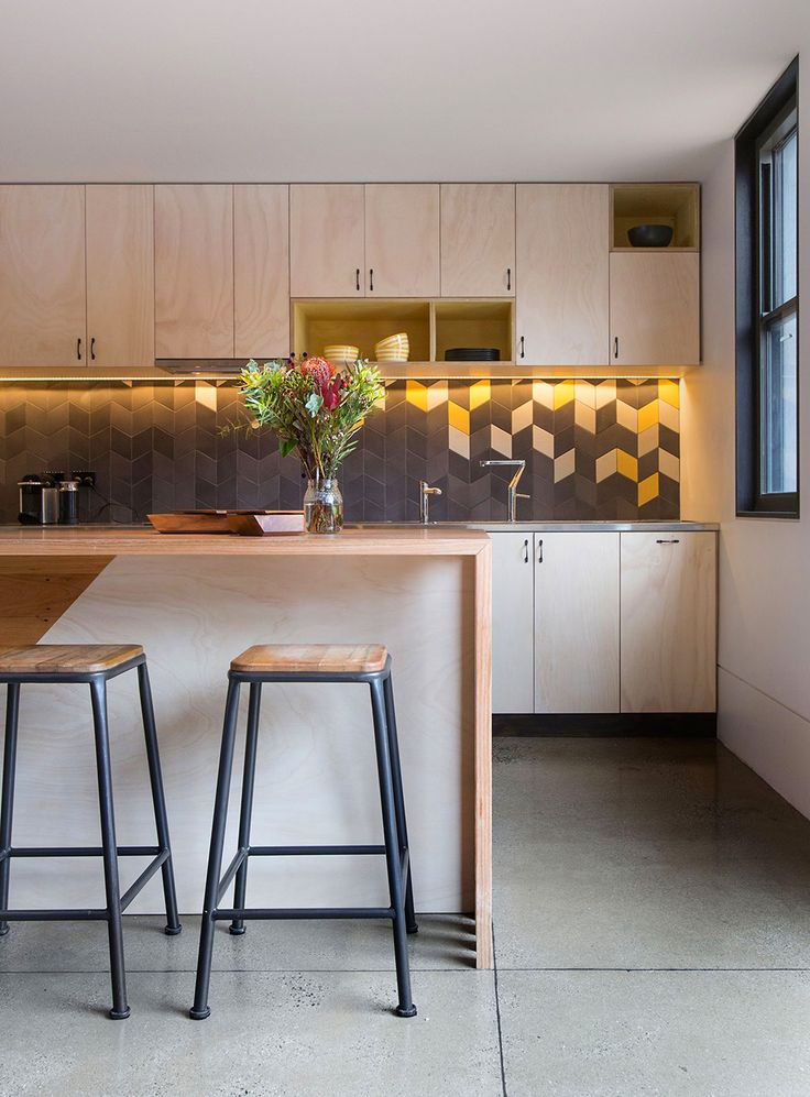 Stonewood Suburb House in Melbourne by Breathe Architecture tex tiles on the wall wooden island