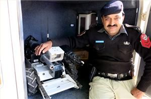 """Peshawar, Pakistan - Braving sniper fire, increasingly sophisticated improvised explosive devices (IEDs), and the escalating use of booby-trapped bombs, Peshawar's small band of bomb disposal experts quietly go about their business.  """"To be a bomb technician, you must have heart, and the will to save lives,"""" says Zahid Rehman, a 45-year-old police officer in this city, considered to be the frontline urban area in Pakistan's war against armed anti-state groups.  Over the course of a 10-year…"""