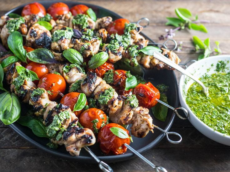 Grilled chicken skewers don't always need a long marinade to be full of flavor. These spend just a few minutes in a lemony, garlicky mix before they're grilled. The hot chicken absorbs the flavor of the fresh basil chimichurri, and the grilled cherry tomatoes bring sweetness and acid.