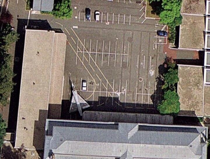 Fighter jet in parking lot