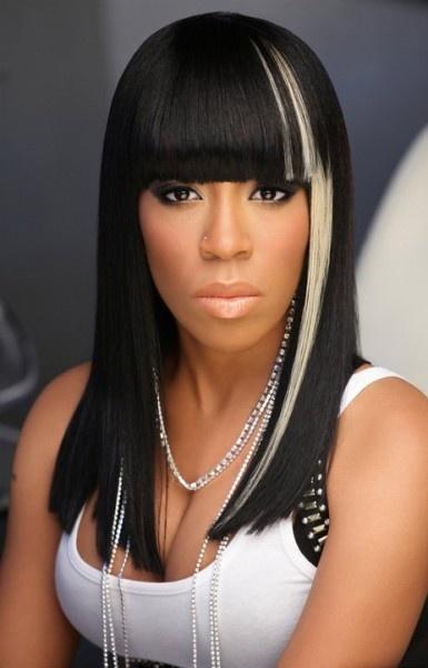 K Michelle nice weave style...love the rogue streak
