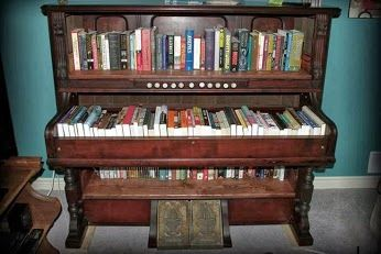 Repurposed piano into book shelves and storage.