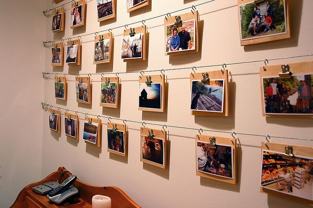 Easy & Inexpensive Wire Photo Display: http://curbly.com/  also: http://tinyurl.com/25fnecf