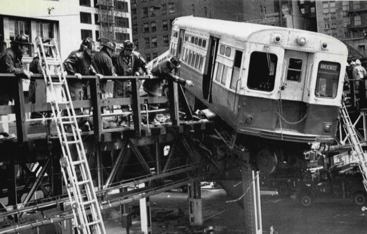 A derailed 'L' car above Lake and Wells, 1974, Chicago. Posted on the Facebook Chicago L group by Joe Kopera.