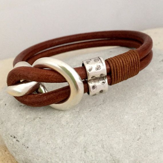 Silver buckle and leather bracelet