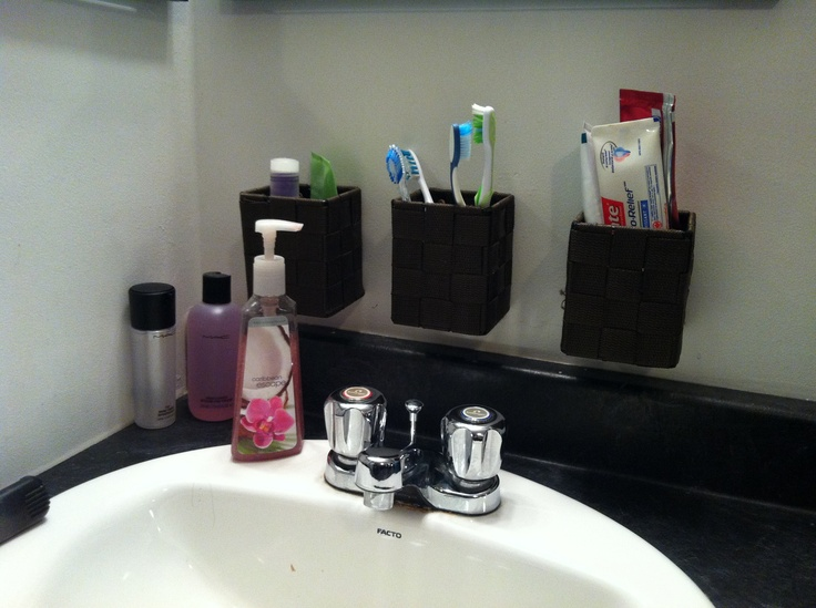 I bought dollarama containers and craig hung them on the wall..way more organized and less clutter around the sink!
