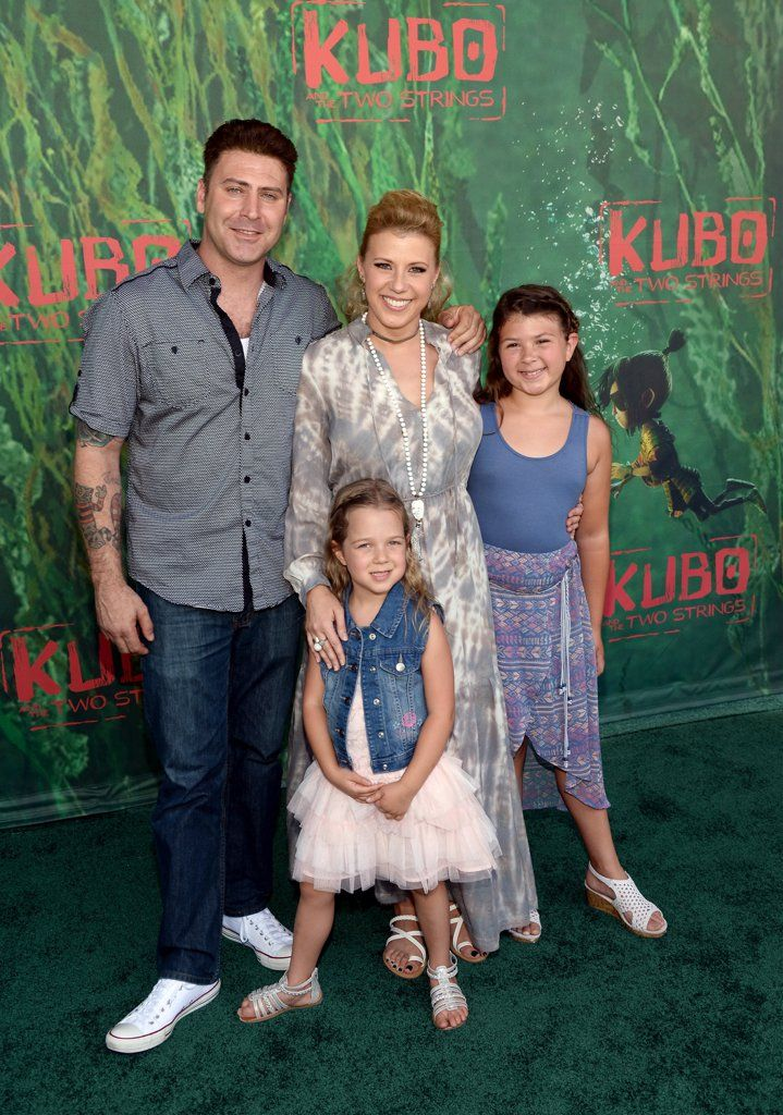 Jodie Sweetin with her fiancé, Justin Hodak, and her two daughters, Beatrix and Zoie.