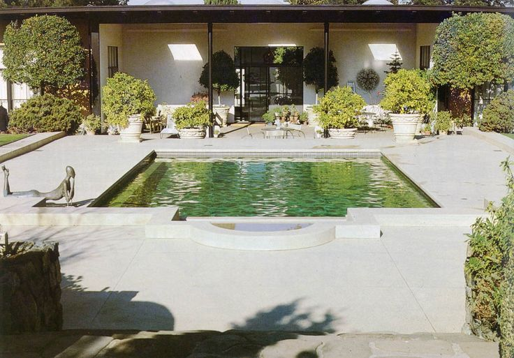 Garden by Thomas Church in the San Francisco Bay Area, 1950. Church's early designs were sometimes architectural, using clipped plants and hedges, and gravel surfaces to give year-round form to the garden. The results were symmetrical and simple. Author's photograph