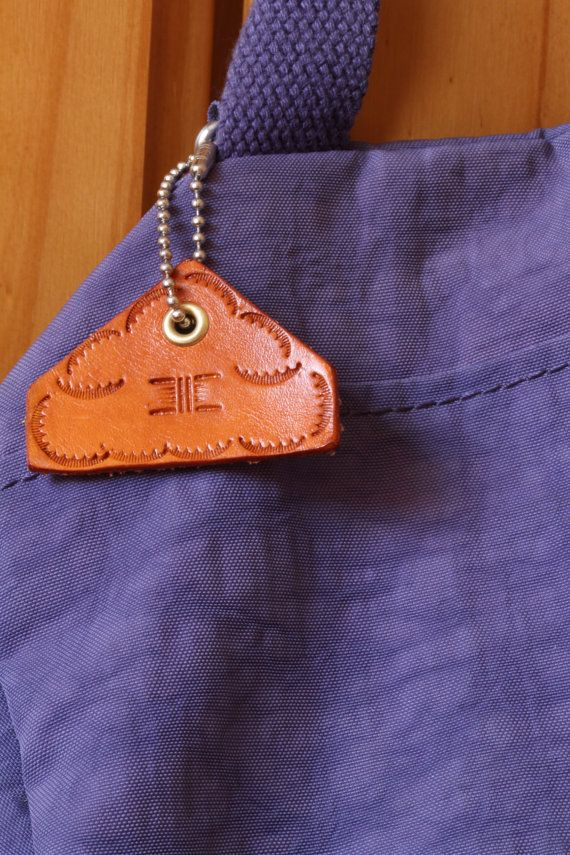 Hand Tooled Leather Bag Charm by Tina's Leather Crafts on Etsy.com.  Repin To Remember.