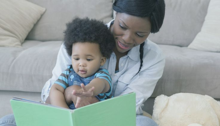 Moms respond more to baby babble when reading than when playing. This could explain why reading is linked to language development, experts say.