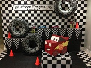 Race-car themed photo backdrop party decoration with Lightning McQueen made from a cardboard box!