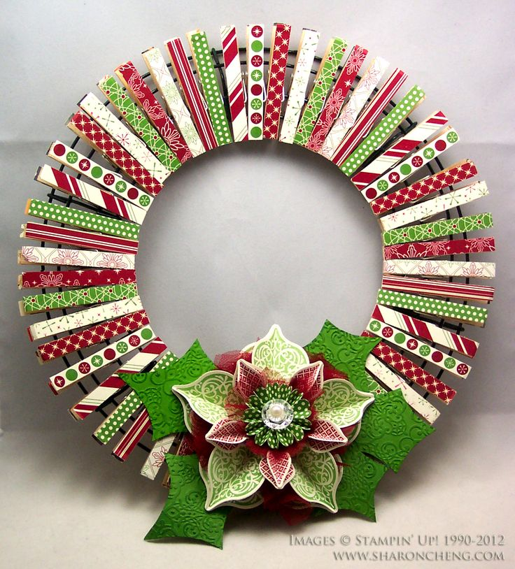 Clothes Pin Wreath #SU - use DSP or Washi tape - This cute Christmas wreath is made using clothespins. Because the wreath uses clothespins pinned to a wire frame, you can decorate the other side of the clothespins for a different season. When it's time to change your decorations for a different holiday, you flip the clothespins around and you have a wreath ready for your next event. I like the idea of using the same wire frame and changing out the clothespins.  Stampin' Up!